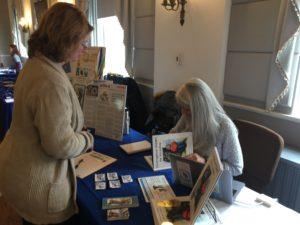 Regina E. McCarthy signing books.